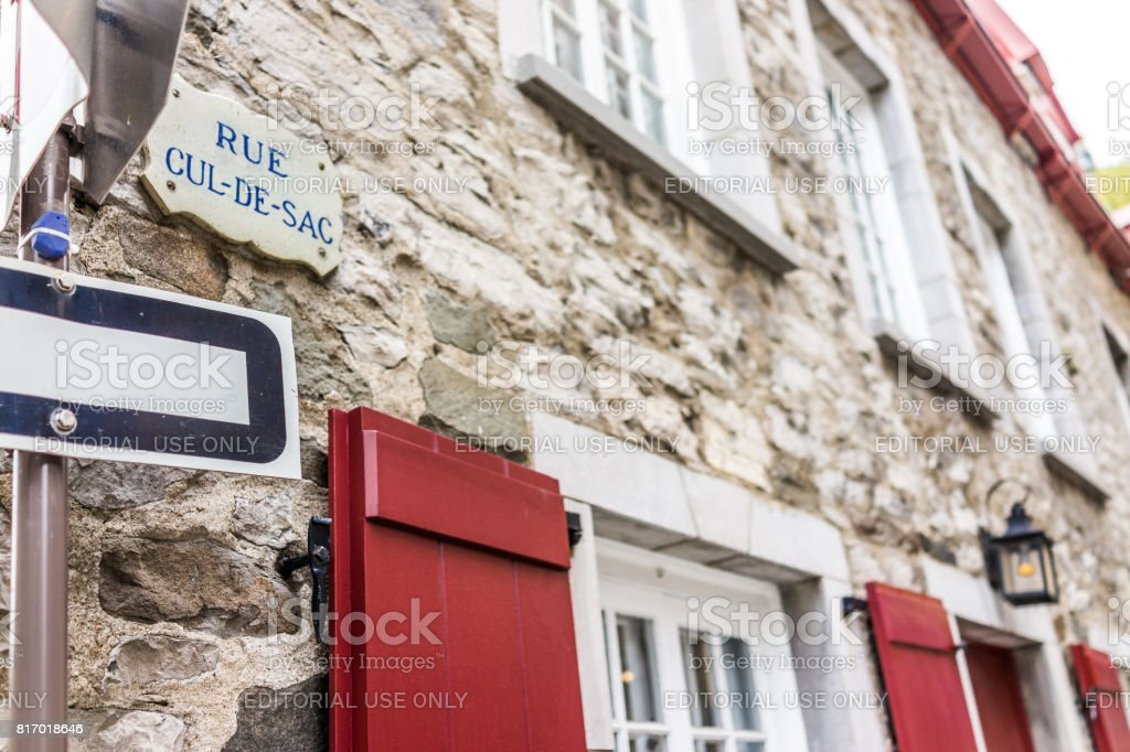 Lower old town street with closeup of Rue Cul-De-Sac sign stock photo