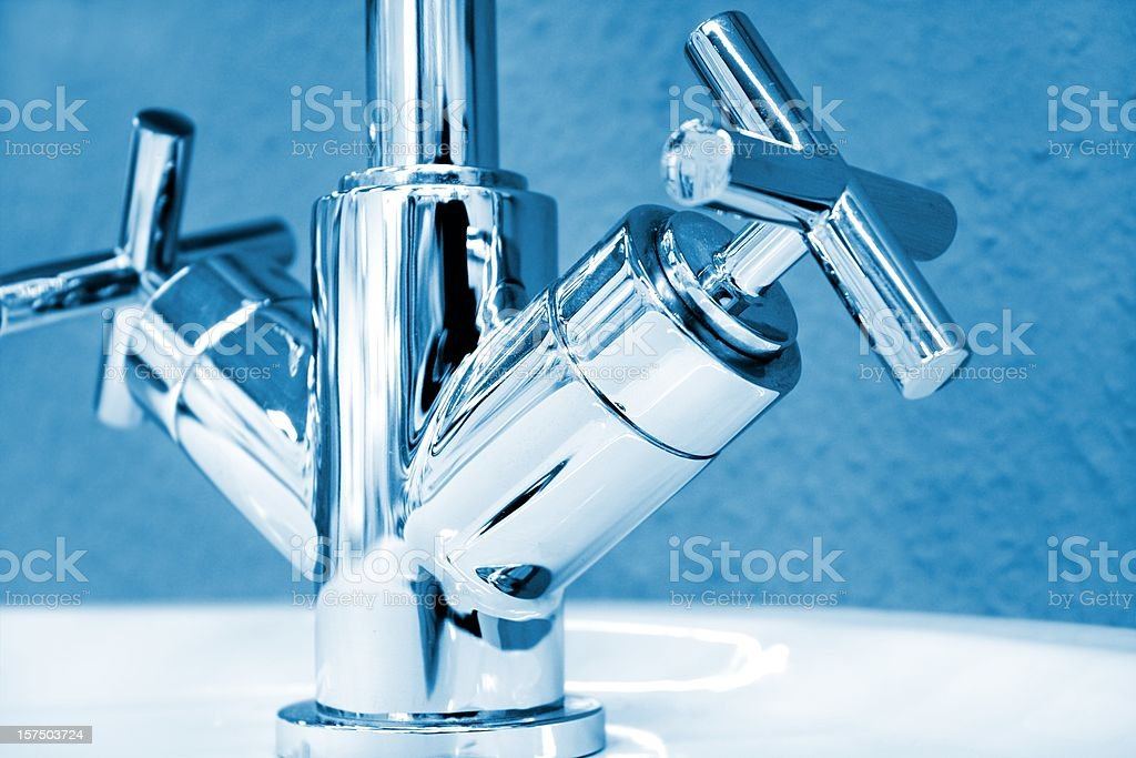 lower part of a new faucet stock photo
