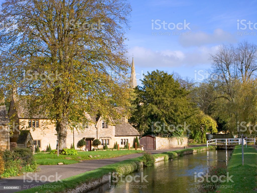 Lower Slaughter in autumn, riverside cotswold stone cottages stock photo