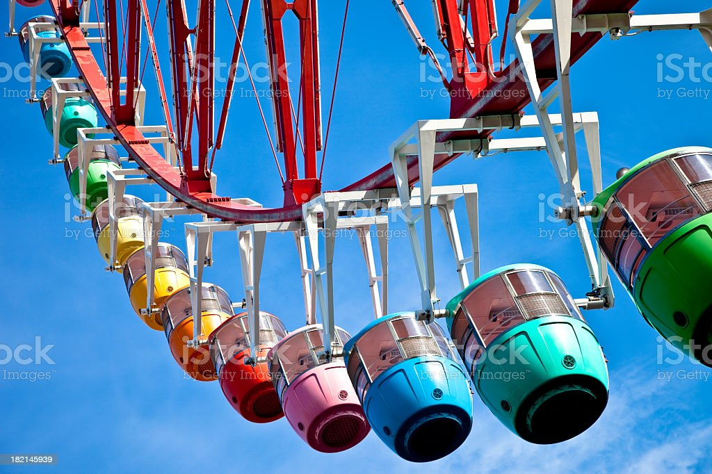Lower view of hanging seats on a Ferris Wheel royalty-free stock photo