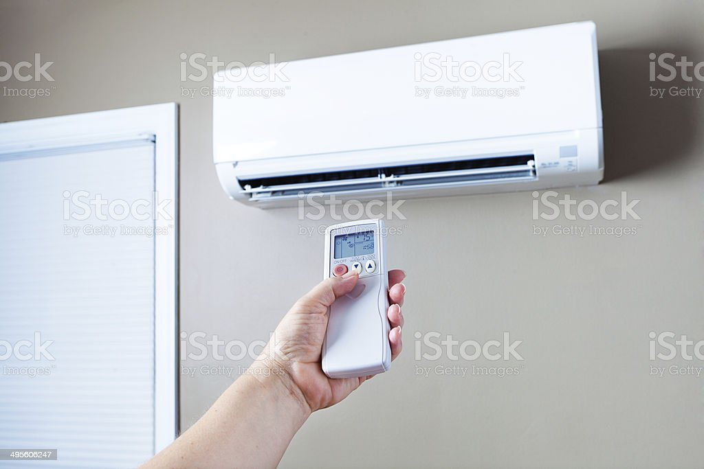 Lowering and Turning Off Air Conditioning to Conserve Eletricity Energy stock photo