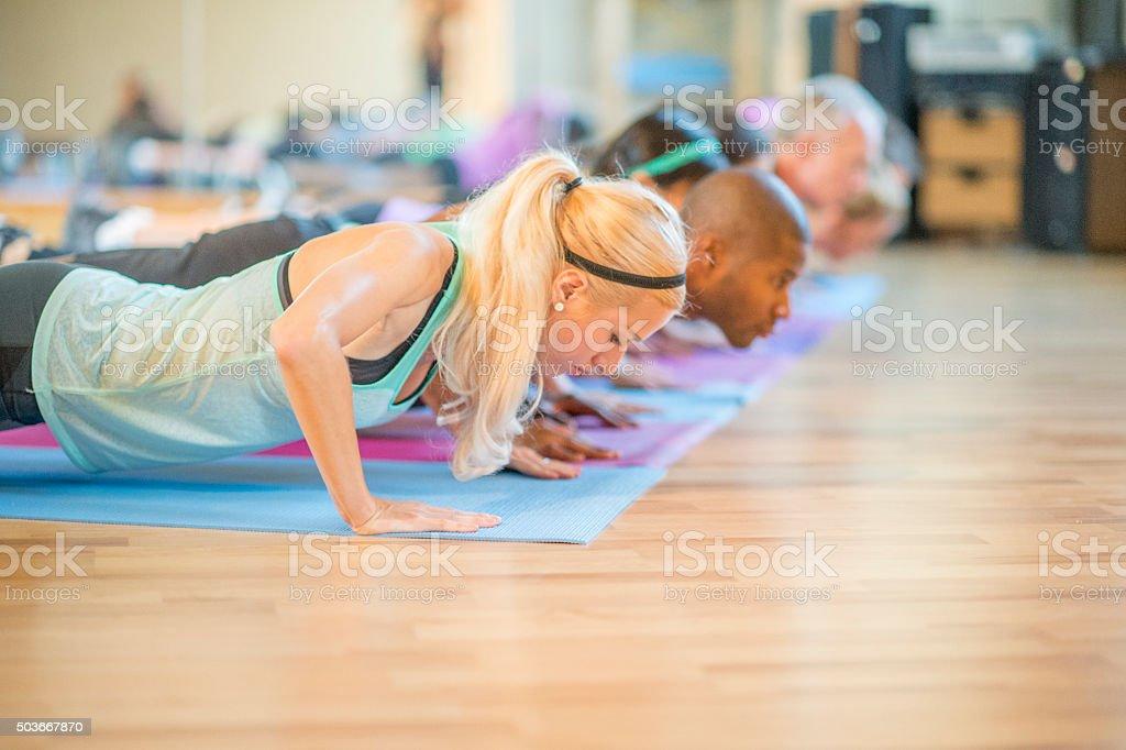 Lowering into Plank Pose stock photo