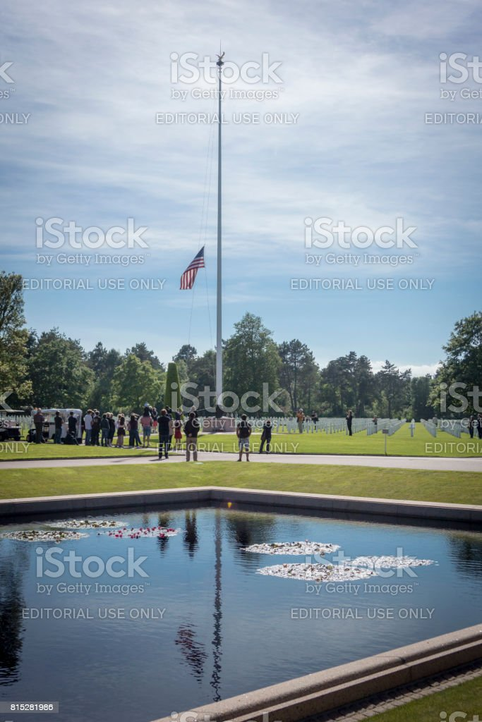 Lowering the American Flag, Normandy stock photo