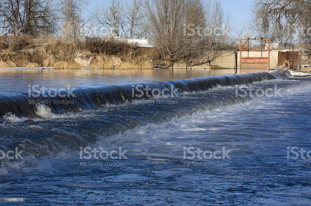 Lowhead river dam diverting water for farmland irrigation stock photo