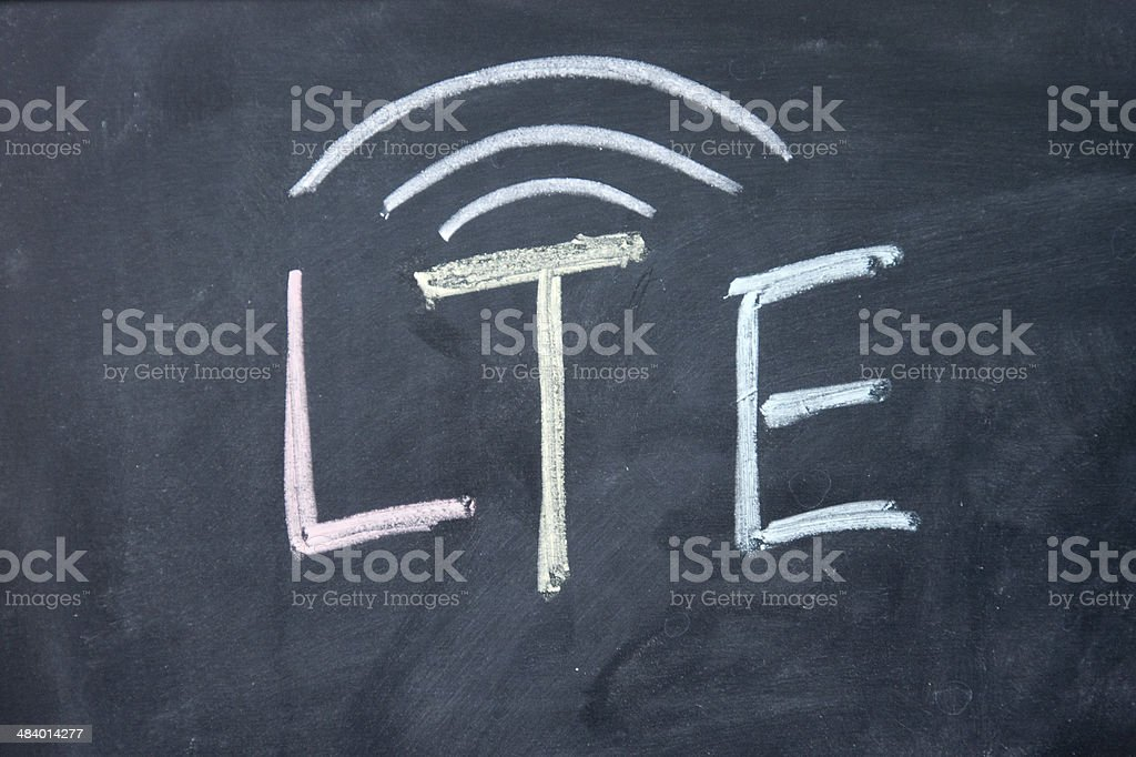 lte sign drawn with chalk on blackboard stock photo