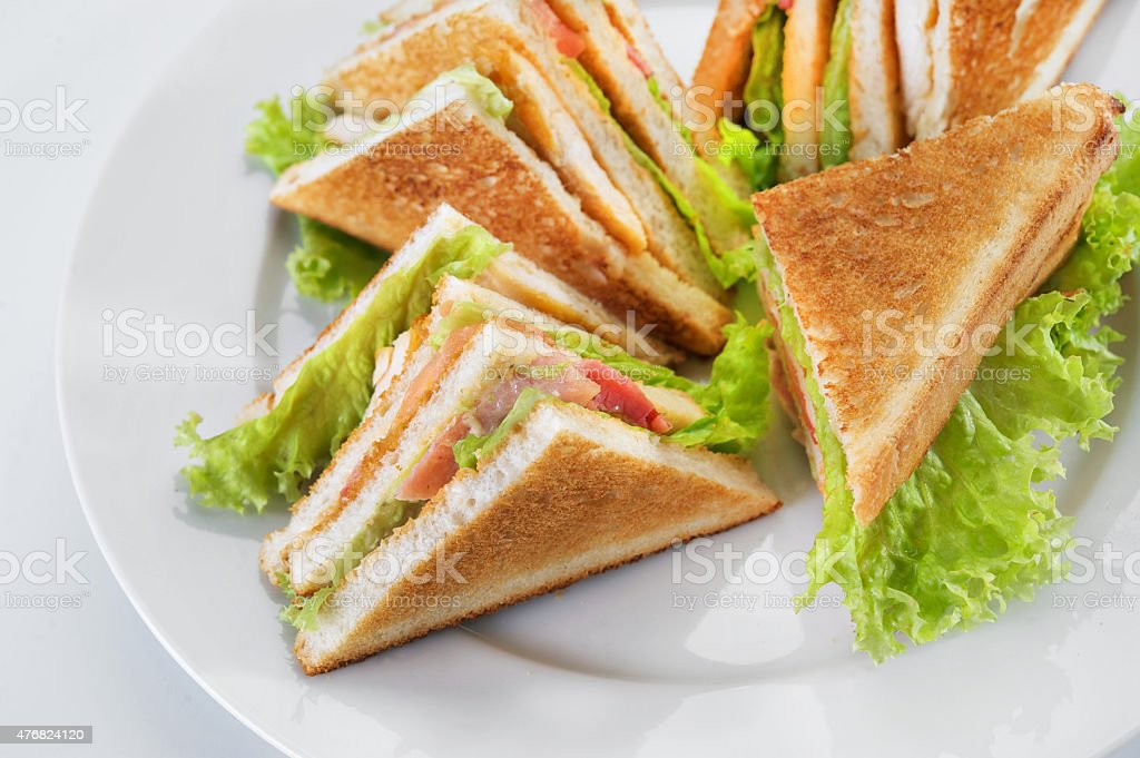 Сlub sandwich on a white plate isolated on a white background stock photo