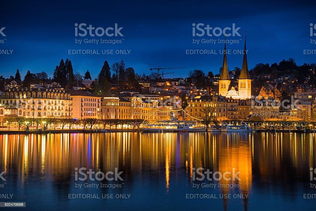 Lucerne nighttime cityscape, St. Leodegar church stock photo