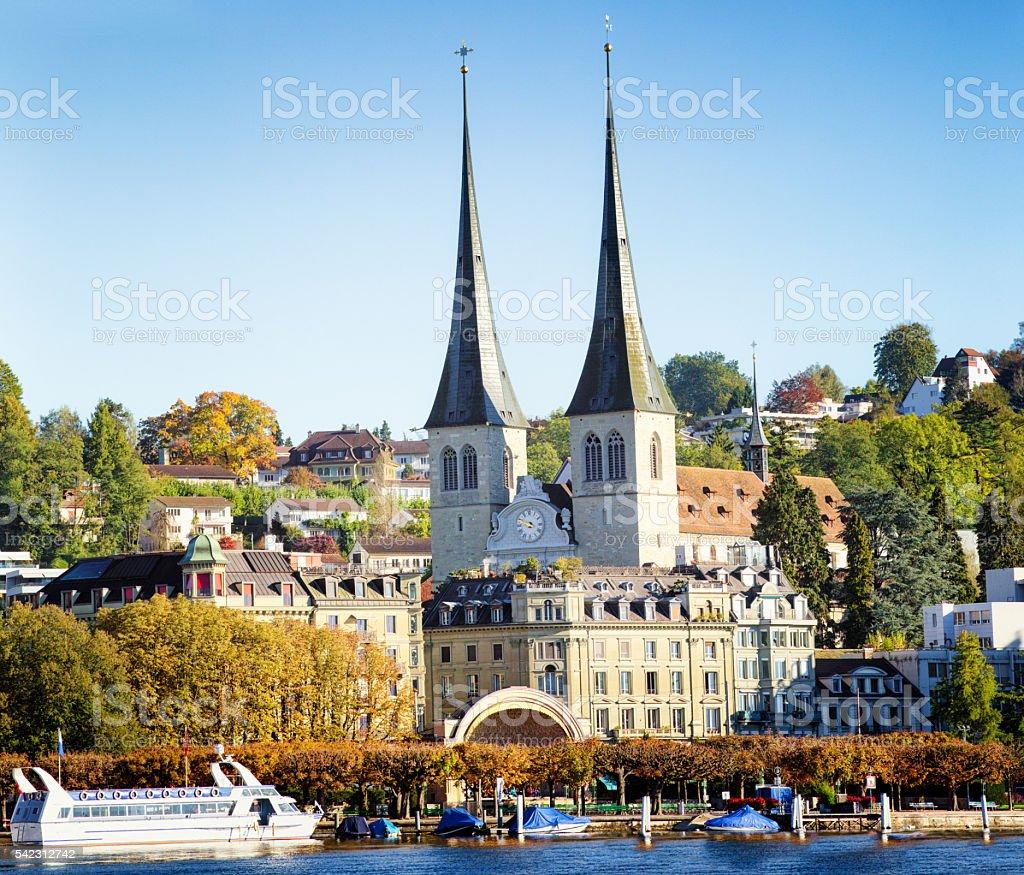 Lucerne Saint Leodegard church and lake shore at Autumn stock photo