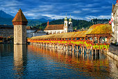 Lucerne, Switzerland, flower decorated Chapel Bridge and Water Tower