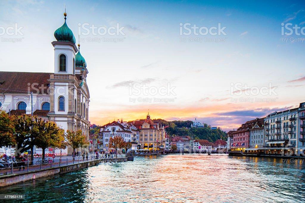 Lucerne Switzerland Reuss river with Jesuit church at sunset Autumn stock photo