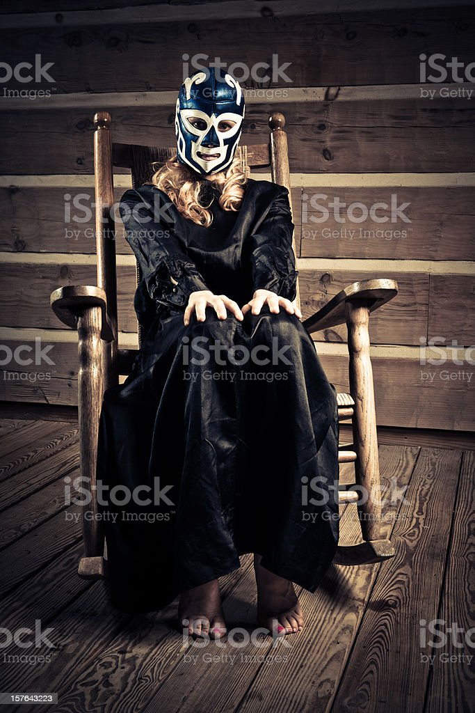 lucha libre wrestler wife waiting in the porch stock photo