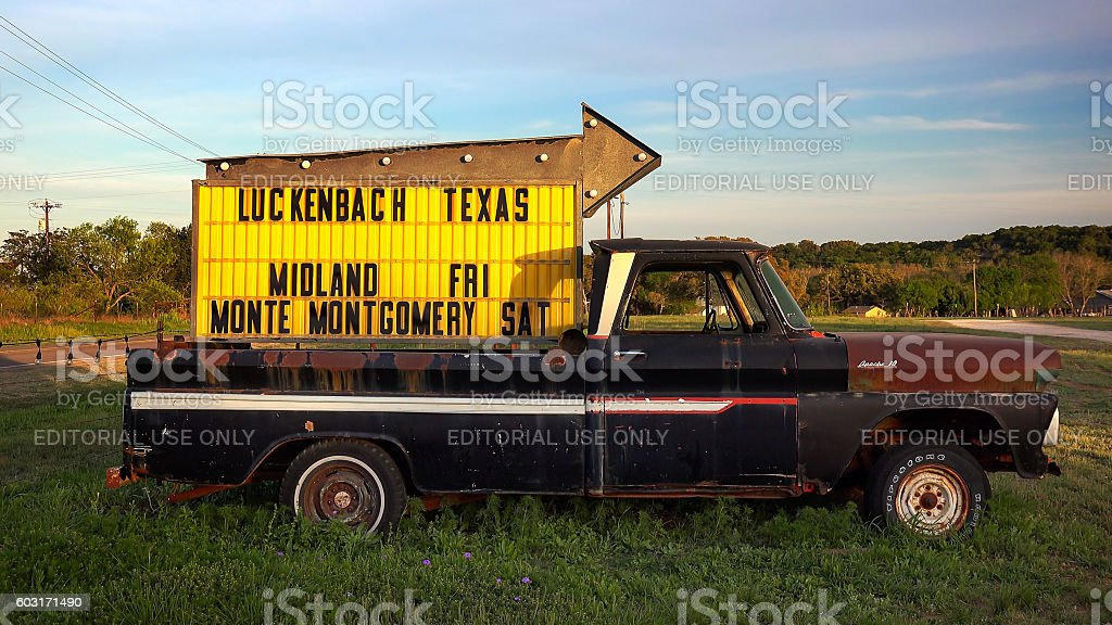 Luckenbach Texas - sign on truck points the way stock photo