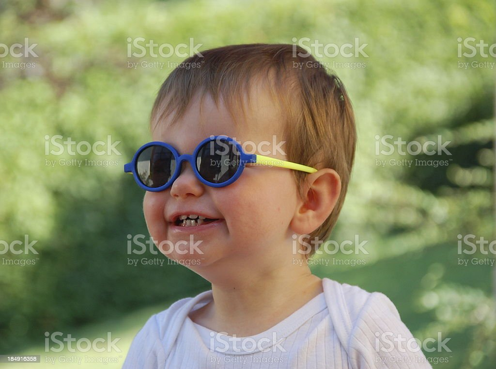 lucky baby with sun glasses royalty-free stock photo