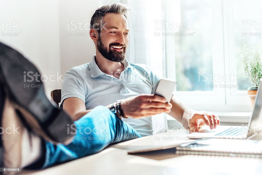 lucky bearded man makes business in the web at home stock photo
