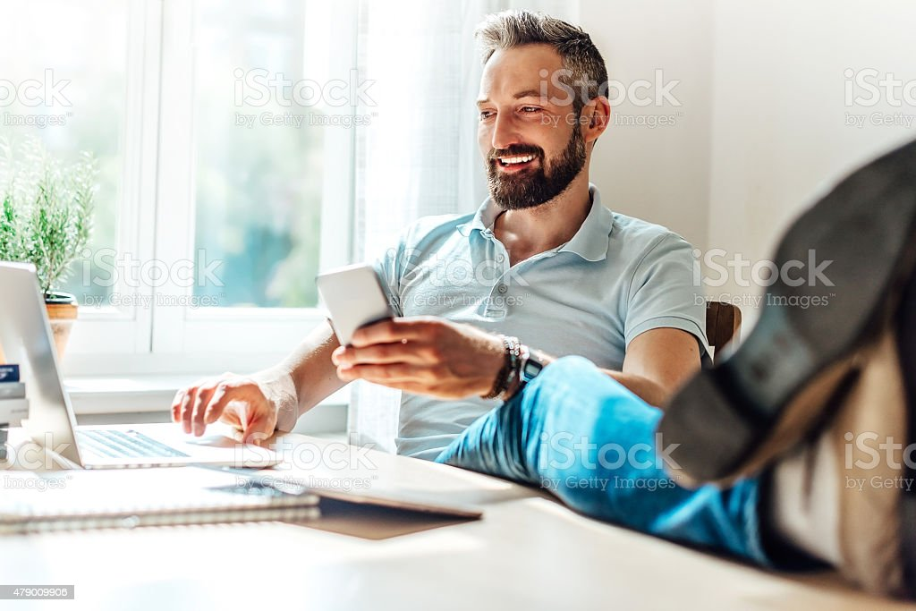 lucky bearded man makes business in the web stock photo