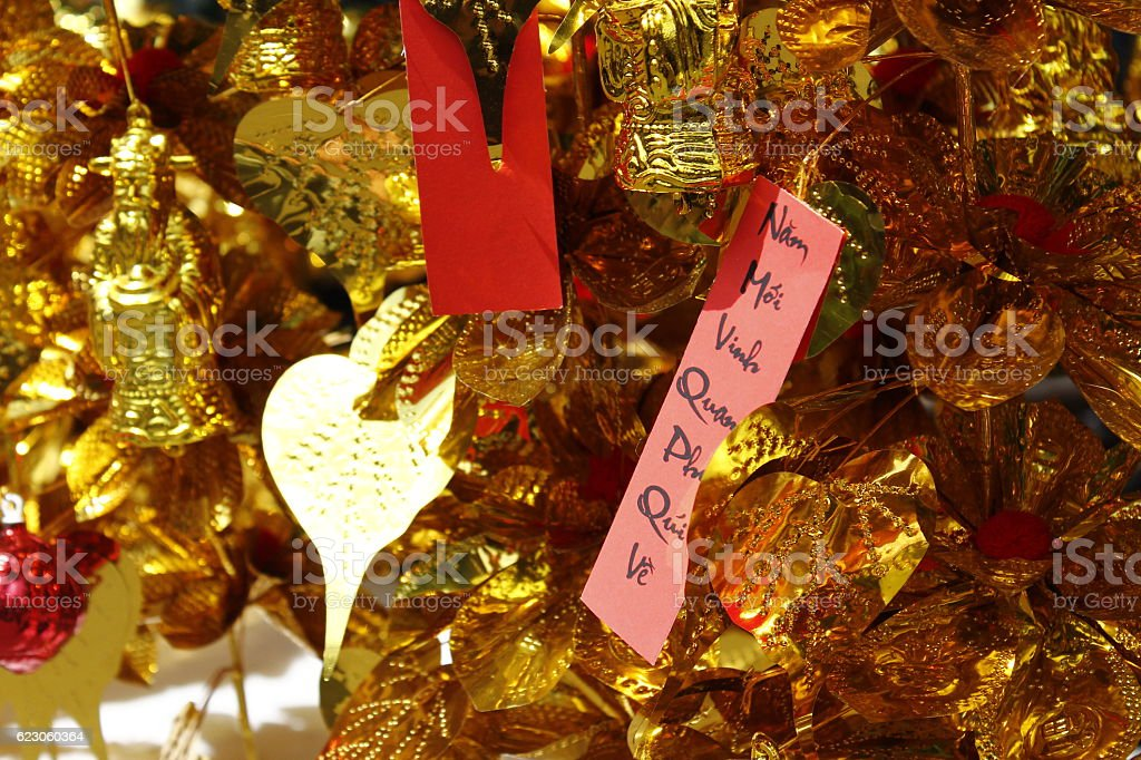 Lucky calligraphy on red paper, hanging on decoration gilded tree stock photo