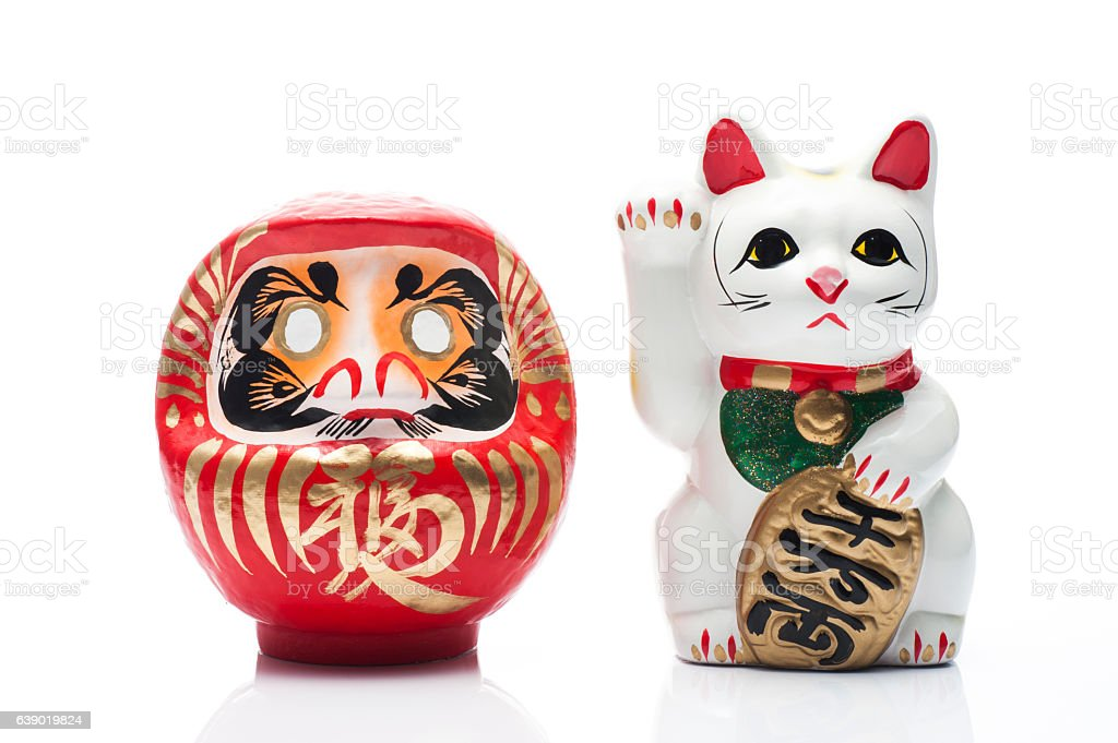 lucky cat and dharma on white background stock photo