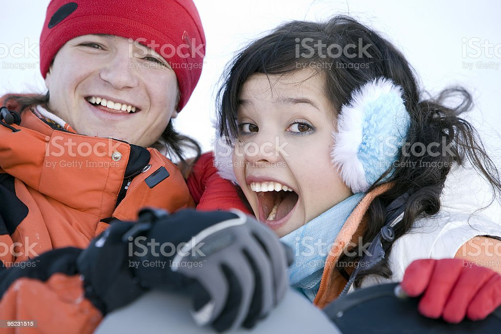 Lucky couple  snowboarders stock photo