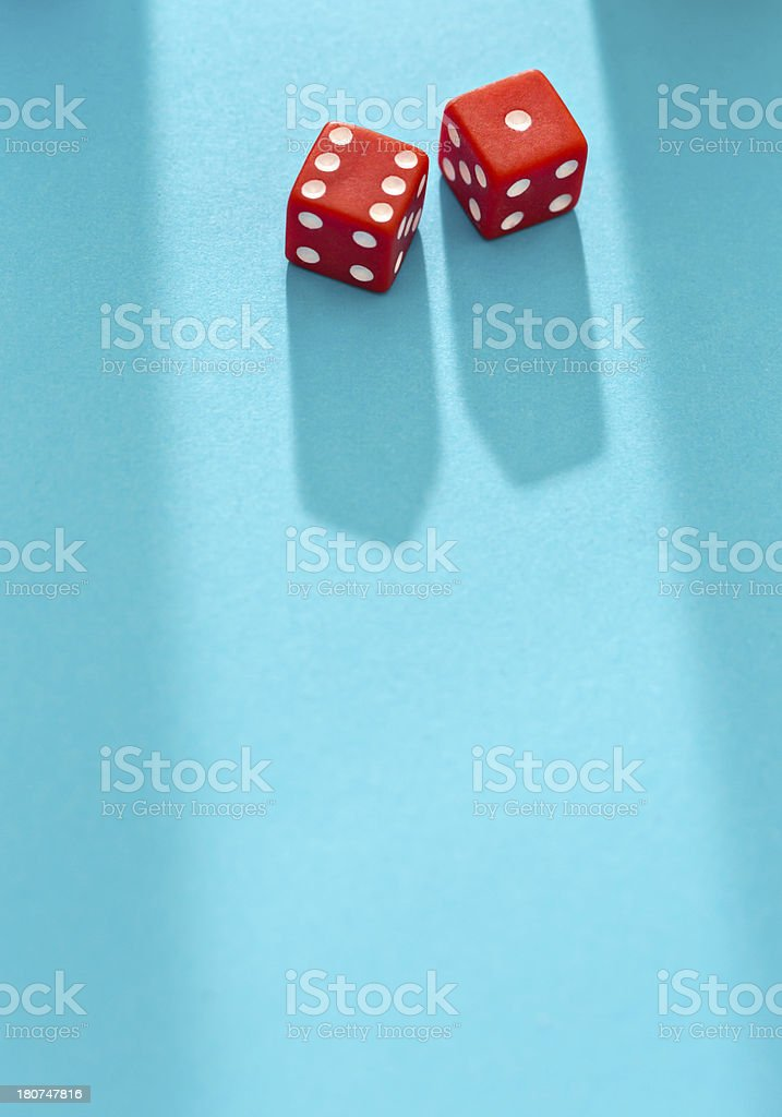 Lucky for some: red dice on blue background score 7 royalty-free stock photo