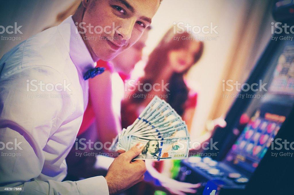 Lucky guy in casino. stock photo