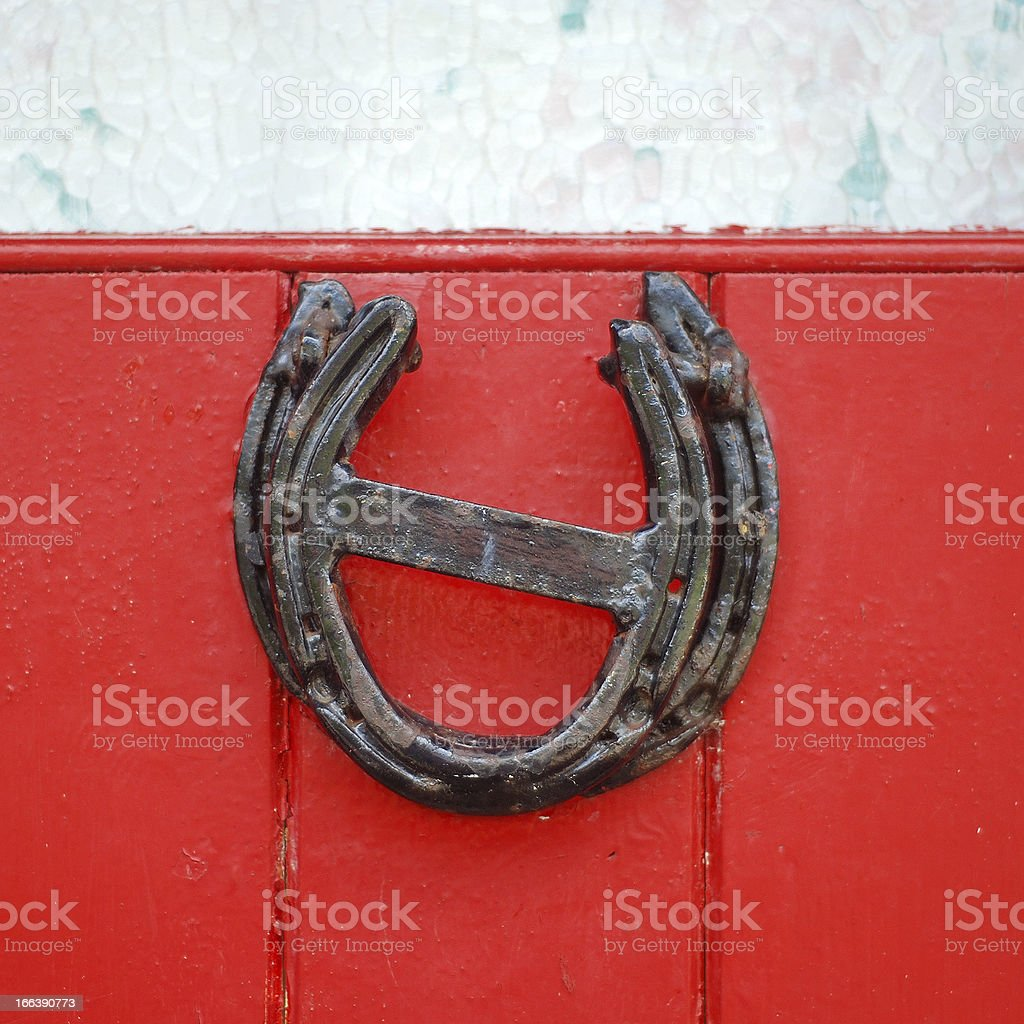 Lucky horseshoe on red painted door of traditional Irish cottage royalty-free stock photo