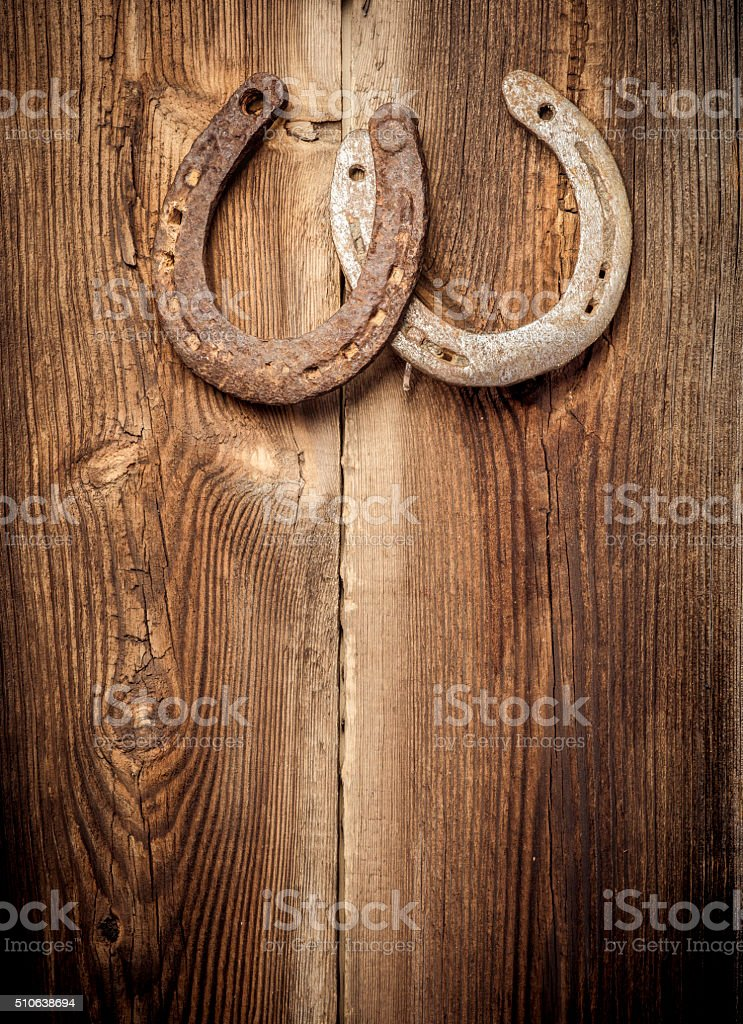 Lucky Horseshoes On Old Wall stock photo