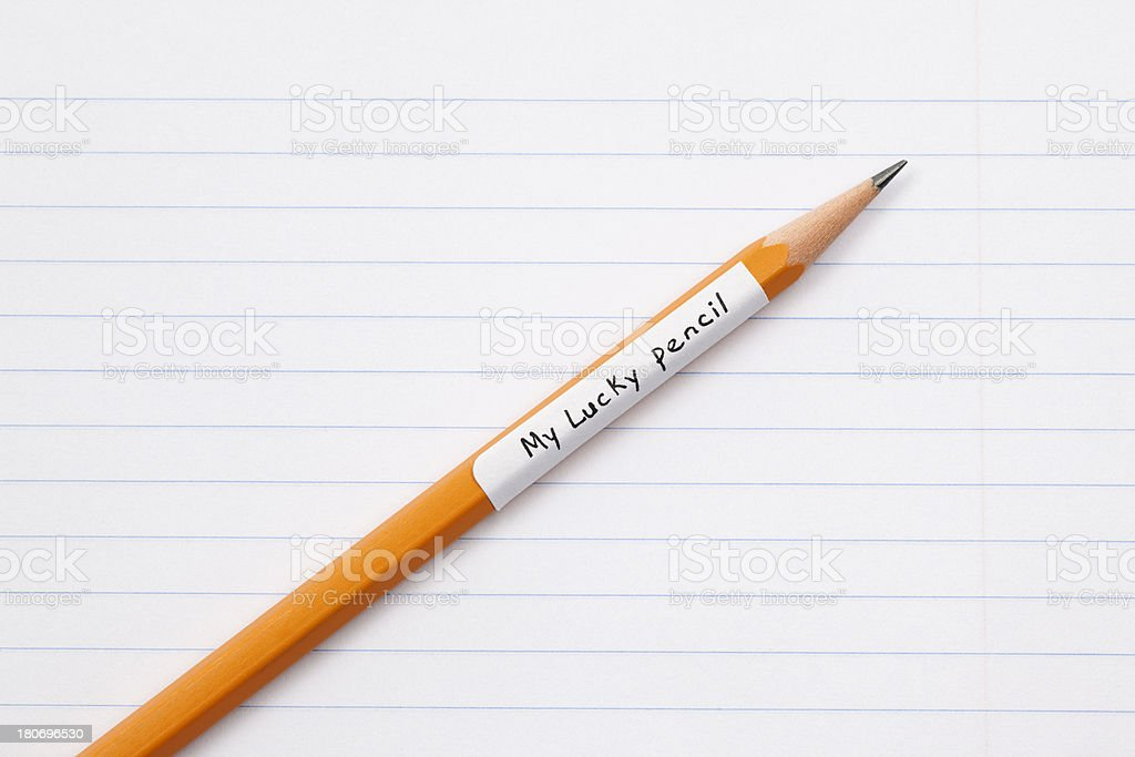 Lucky Pencil on Blank Sheet of Paper royalty-free stock photo