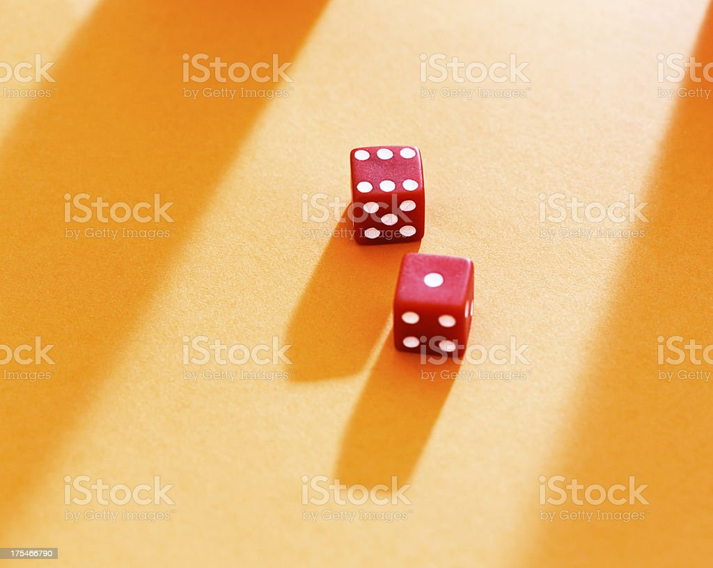 Lucky throw; red dice on yellow show score of 7 royalty-free stock photo