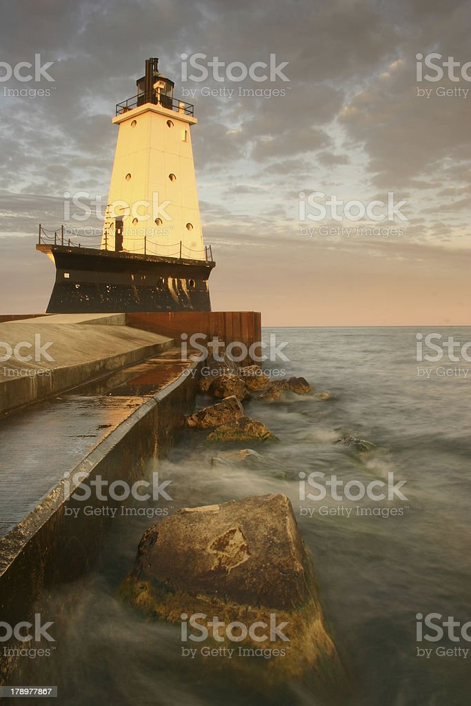 Ludington Breakwater Lighthouse and Rocks, Lake Michigan royalty-free stock photo