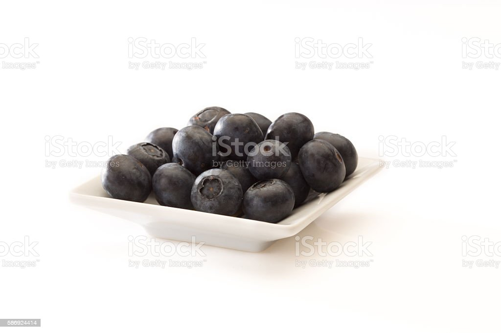 lueberries on a whit plate stock photo