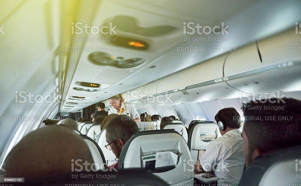 Lufthansa Airlines adventure travel inside plane with steward se stock photo