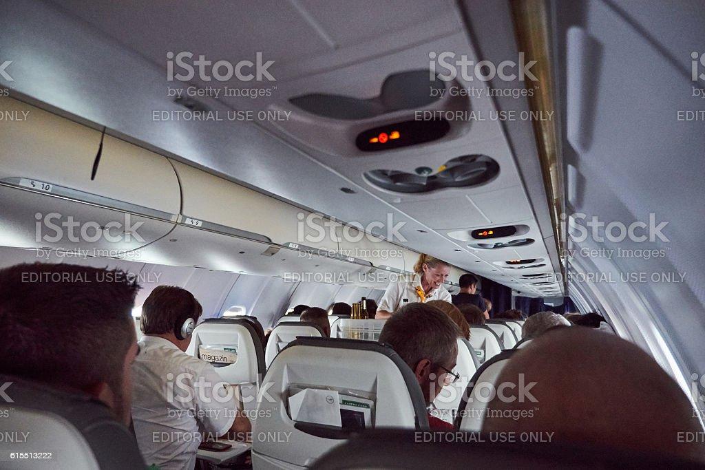Lufthansa Airlines adventure travel inside plane with steward seward stock photo