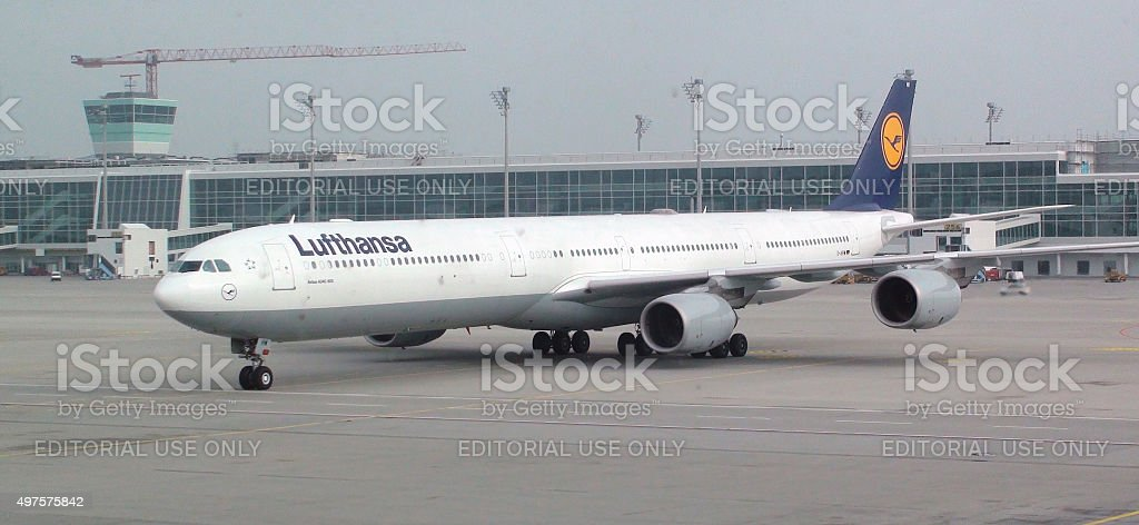 Lufthansa Airlines Passenger Airplane Departing From Loading Gate.Munich Airport stock photo