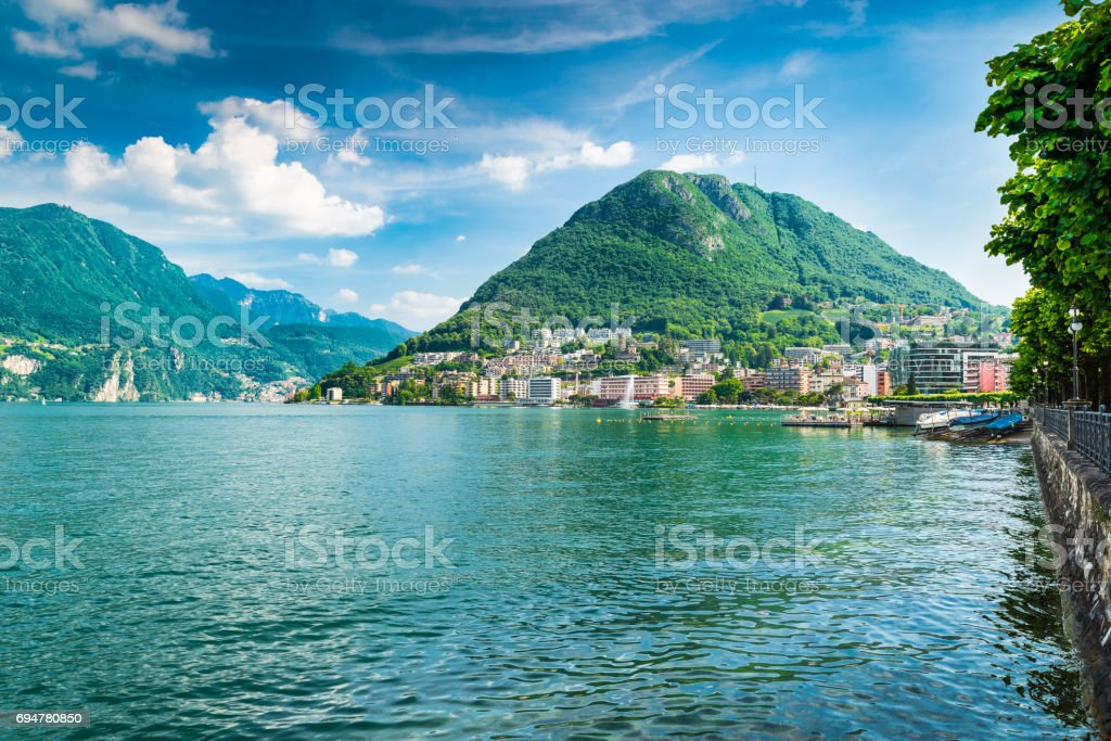 Lugano, Canton Ticino, Switzerland. Lakeside and Lake Lugano on a beautiful summer day. Lugano - Paradiso and Monte San Salvatore stock photo