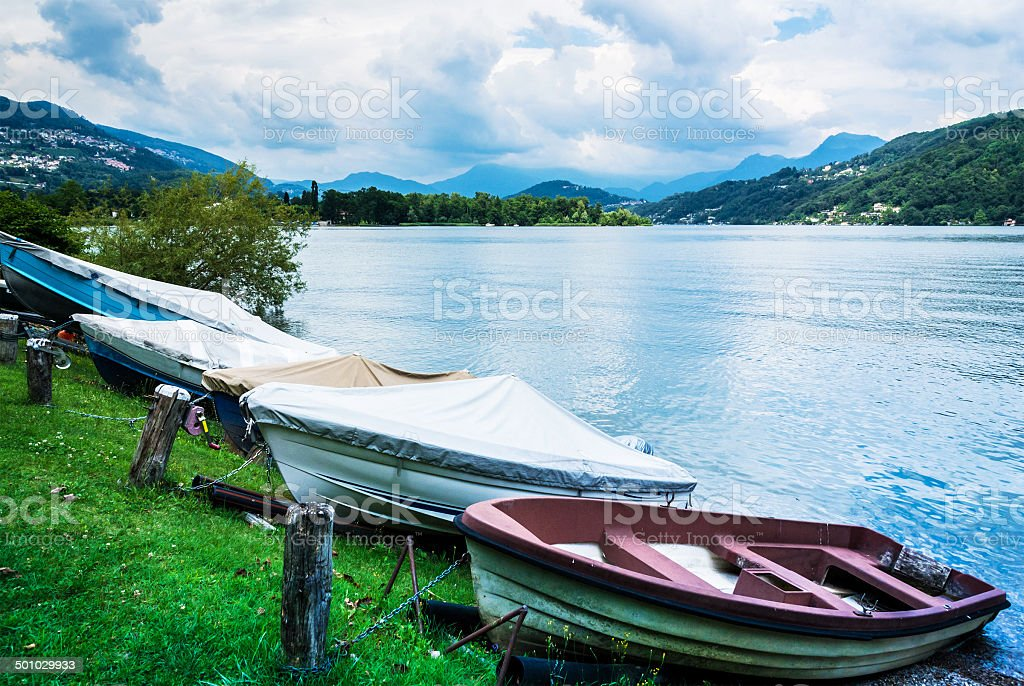 Lugano Lake, boats at rest on the grass stock photo