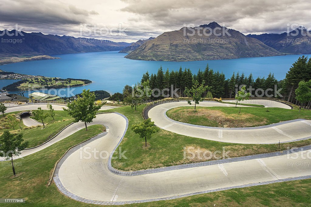 Luge track with beautiful lake and mountain stock photo