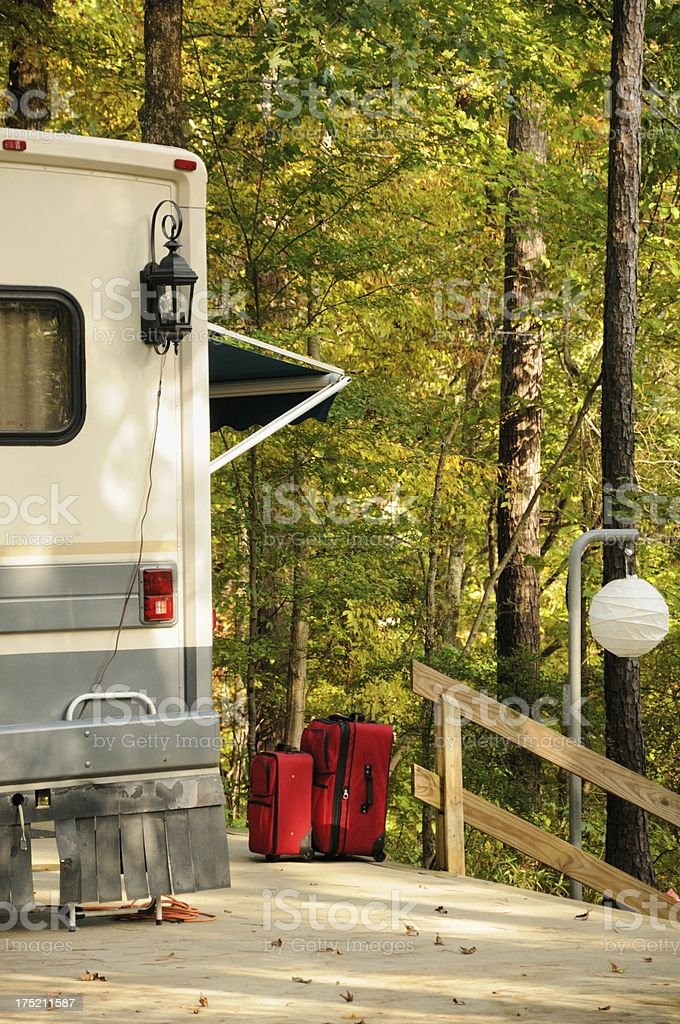 Luggage by motorhome in campsite royalty-free stock photo