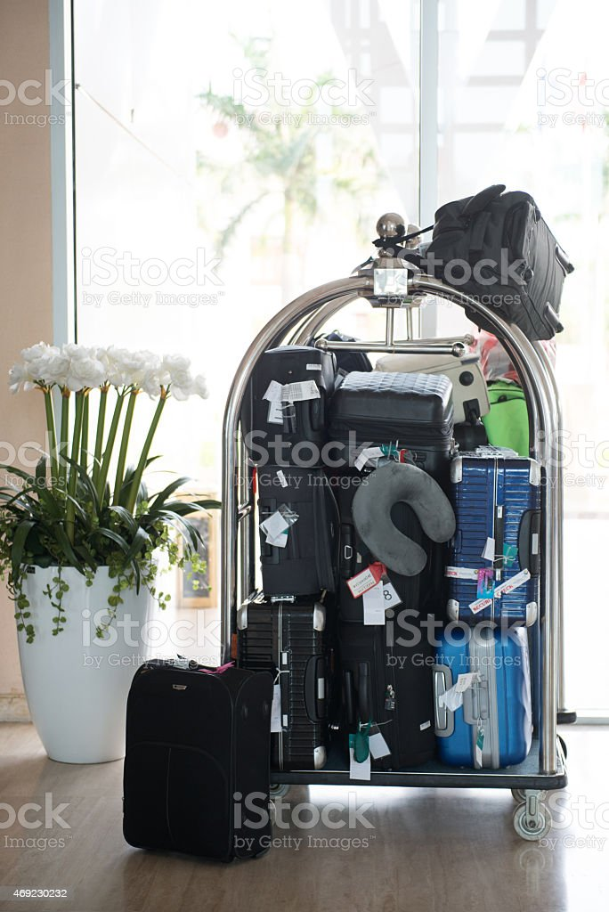 luggage cart in hotel stock photo