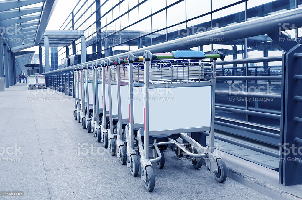 luggage carts at modern airport stock photo