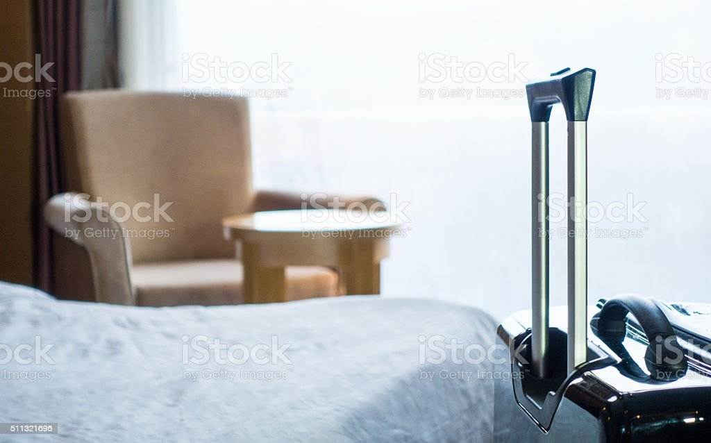 luggage in a hotel room stock photo