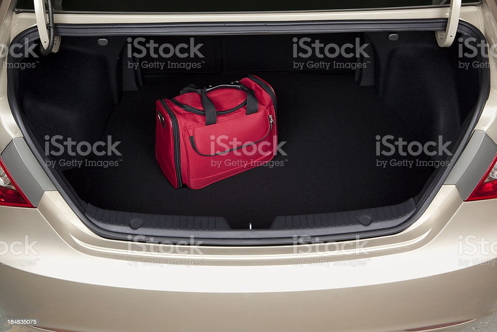Luggage in Car Trunk stock photo