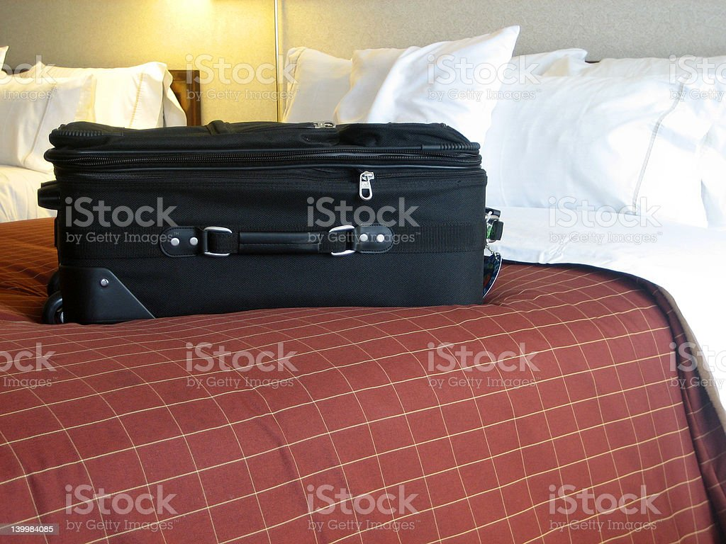 luggage in hotel room stock photo