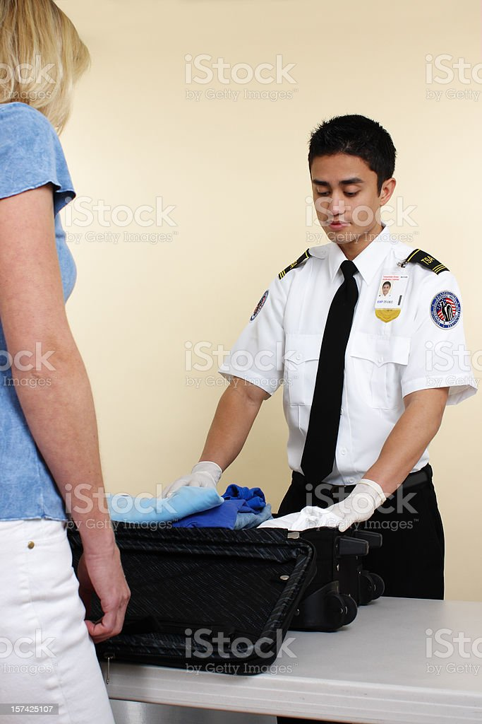 Luggage Inspector stock photo