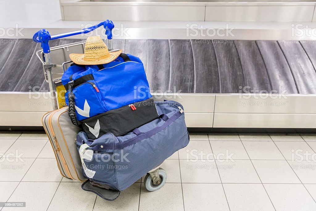 Luggage near baggage band at airport stock photo