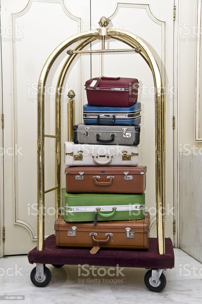 Luggage stack on a rack stock photo