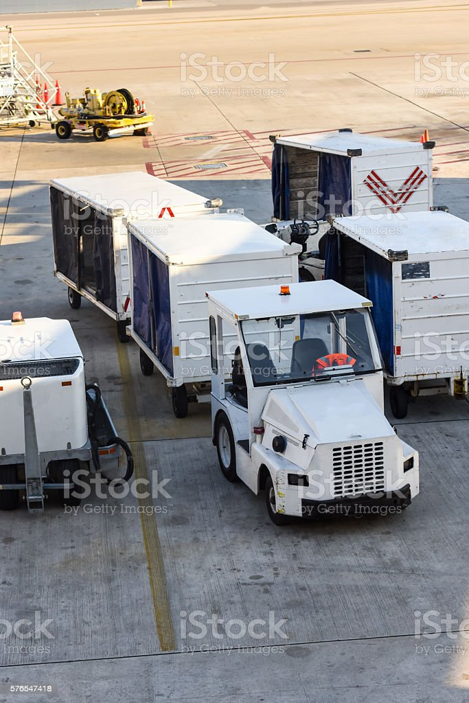 Luggage Transport Vehicles at the airport stock photo