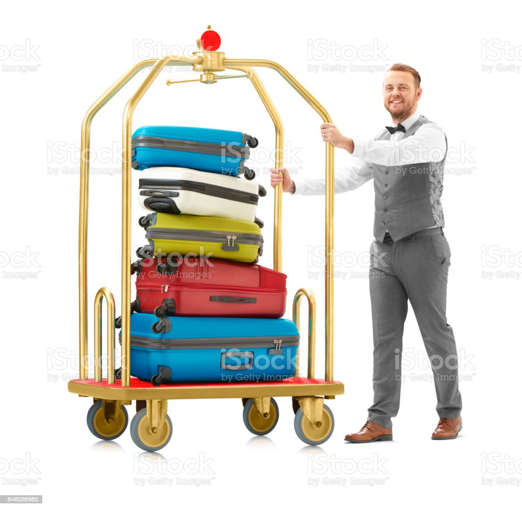 luggage trolley and bellboy stock photo