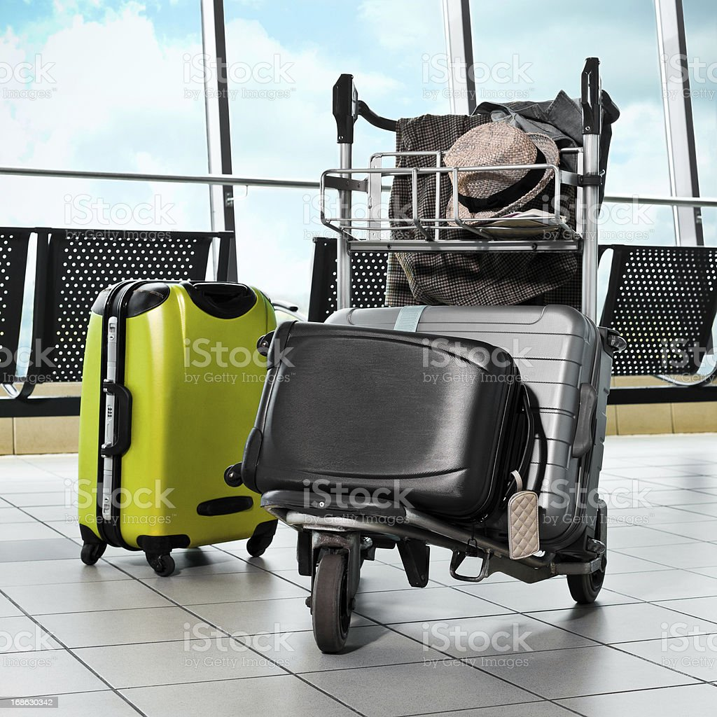 Luggage trolley with suitcases stock photo
