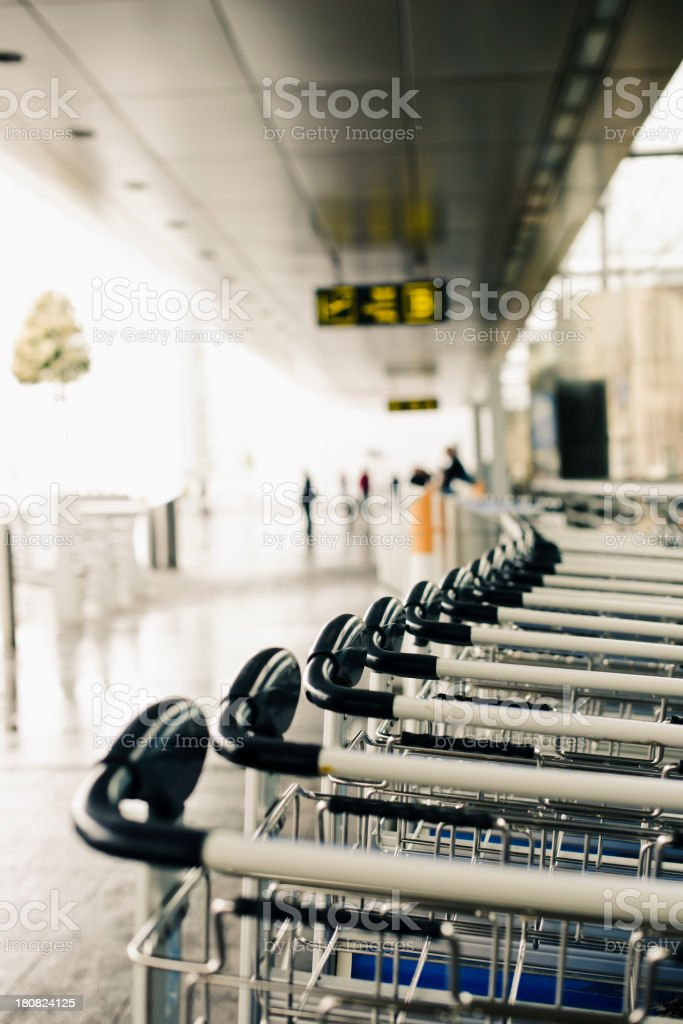 Luggage trolleys at the airport royalty-free stock photo