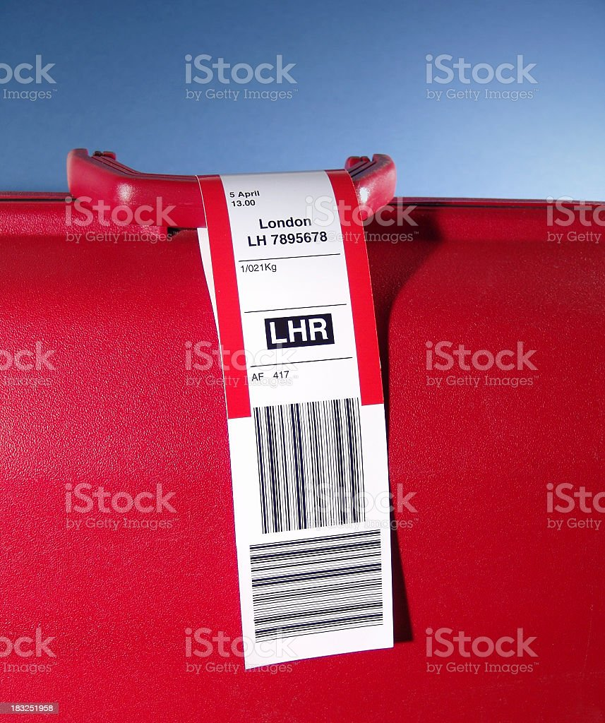 Luggage with a tag explaining that it is bound for London stock photo